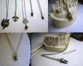 Deal of the Day! Choice of 2 necklace for 20. Vulpes (fox), Nola (fleur de lis), Seven Swords (Our Lady of Sorrow), Pinecone, Wisdom (molar)