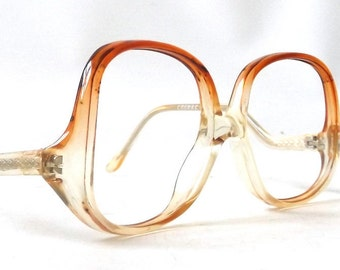 vintage 1970s NOS eyeglasses oversized round clear cognac brown plastic frames prescription womens eye glasses eyewear retro drop arm modern
