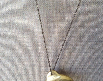 golden brass jumping dolphin necklace