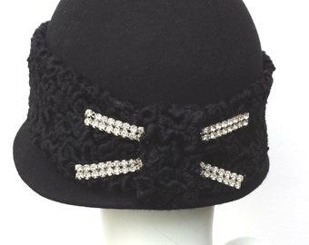 Black wool felt cloche with faux astrakhan persian lamb fabric trim and diamante back