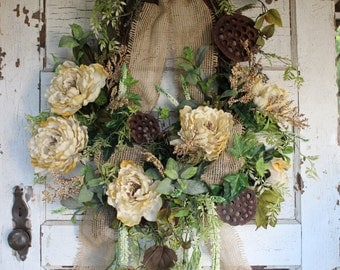 Rustic, elegant grapevine wreath with burlap ribbon and cream colored flowers and folaige / ivory peonies, home decor, sympathy flowers,