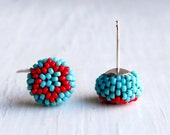 Handwoven Button Stud Earrings in turquoise-blue with glossy red star of david pattern and sterling silver posts - Songbead UK, narrative