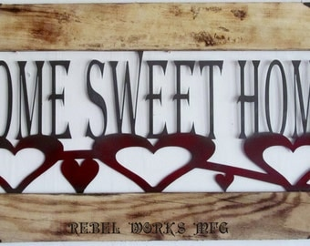 "Home Sweet Home metal sign in wood frame and metal corners. 18.5""Hx39""L"