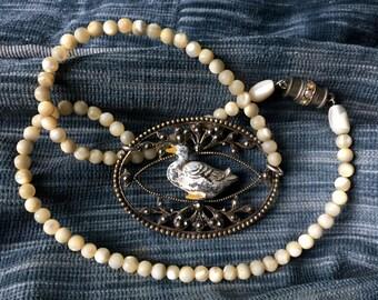 Tiny Duck Necklace. Lead figurine, gander, gosling,buckle, antique toy, antique assemblage, vintage, repurposed