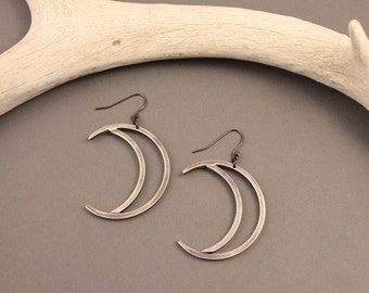 Sky Child sterling silver simple crescent moon earrings