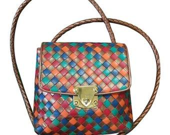 Vintage Bottega Veneta intrecciato shoulder bag, woven leather purse in multicolor of bronze, red, orange, green, and blue.