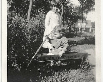 Old Photo Girl with Boy in White Coaster Wagon 1920s Photograph snapshot vintage