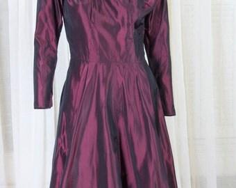 Eggplant colored taffeta dress. 1970s, full skirt, scoop neck