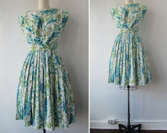 1950s party dress   vintage 50s dress   1950s floral day dress   flower print dress   blue green and white   small   The Chesterfield Dress