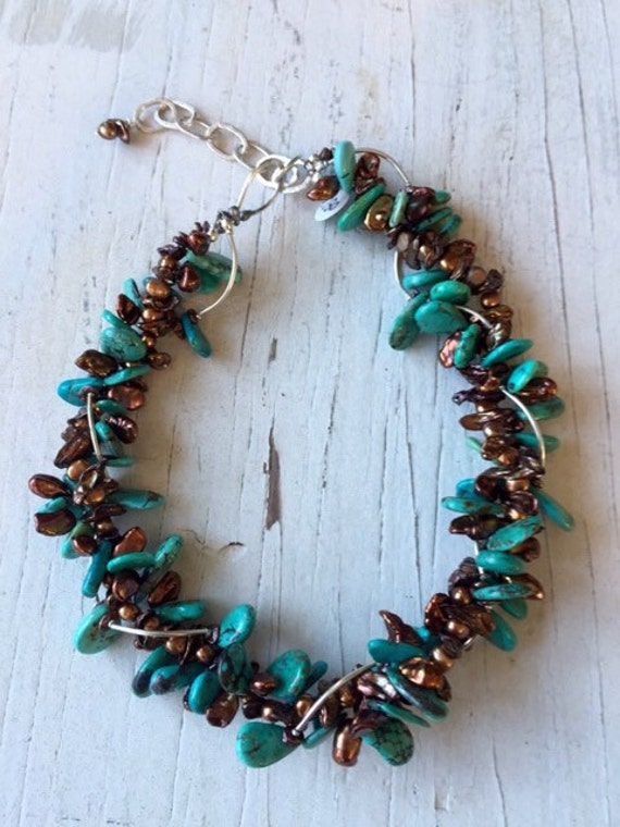 Triple strand turquoise and pearl statement necklace with fine silver accents. Handmade and one of a kind by ladeDAH!