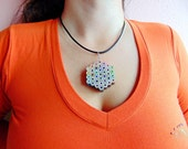 Hexagon shaped rainbow colored pencil crayon necklace pendant with bri...