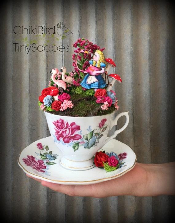 Alice in wonderland tea cup garden fairy tea cup cake for Alice in wonderland fairy garden