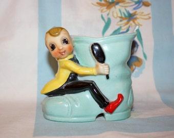 Pixie on boot planter, 1950s