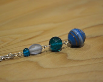 Four beautiful blue, white and gold glass beads on a silver plated chain necklace