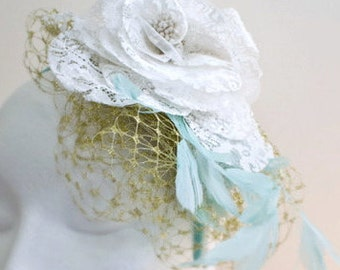 Dazzling gold veiling on an aqua ribbon band