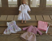 American Girl Mini Doll Kit with four dresses