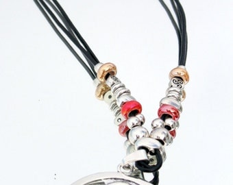 long, black leather necklace with big pendant