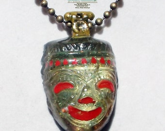 "Smoking Tiki necklace made from ""It's a Mad, Mad, Mad, Mad World"" car glass."