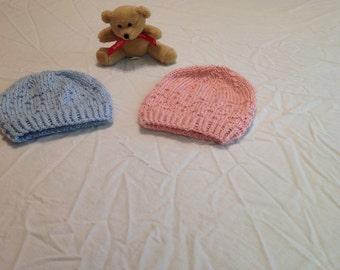 Hand knit blue or pink newborn hats