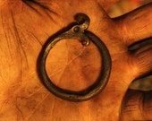 A hand forged Ouroboros/ Midgård/World serpent pendant . Comes supplied with a high quality elk leather thread.