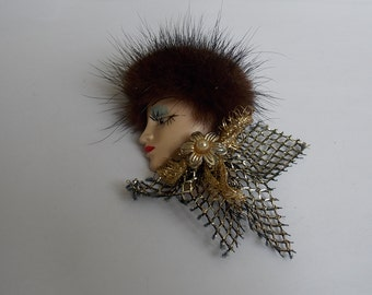 Vintage pin profile of woman of the 1970s old brooch