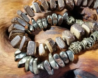 Double strand bracelet with beautiful wood and antiqued brass pewter beads, hematite nuggets, and a magnetic clasp.