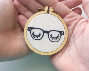 Rayban Style Glasses Necklace>Embroidered Jewelry>Eyes Embroidery Designs>Mini Embroidery Hoop>Vintage Eyeglasses>Fabric Necklace>Gift Idea