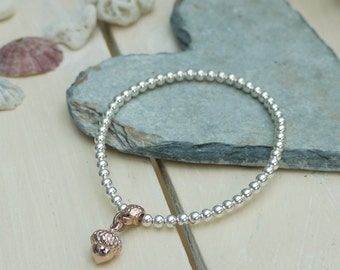 Silver plated beaded bracelet with rose gold Acorn charm