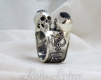 Om Namah Shivaya nielloed silver ring featuring mantra, a couple of black sapphires and a couple of skulls.