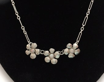 "Sterling silver"" three flower necklace"" with opal stone centers."
