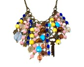 Repurposed Bohemian Waterfall Necklace, Boho, Beaded, Gypsy Jewelry in Pink Blue Yellow, Rosary