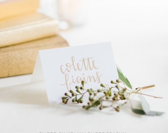 gold calligraphy wedding escort cards // custom handwriting font in gold and silver pen for handwritten place cards