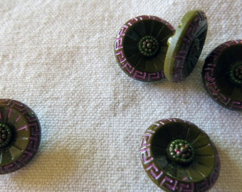Set of 5 round small flower shank buttons with fuchsia decoration on the rim and brown greenish colour hint in the middle.