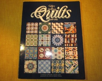 Gallery of American Quilts 1849-1988,collection of 500 quilts,their values,by the American Quilters Society,127 pgs. ,color photos,collector
