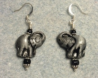 Grey and black Czech glass elephant bead dangle earrings adorned with black Czech glass beads.