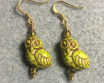 Lime green with copper wash fancy Czech glass owl bead earrings adorned with green Chinese crystal beads.