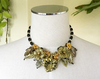 80s gold metallic black mixed metal floral statement necklace plastic beaded over sized trumpet flowers vine leaves