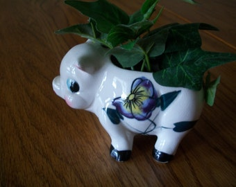 Ceramic pig planter, white with purple flowers