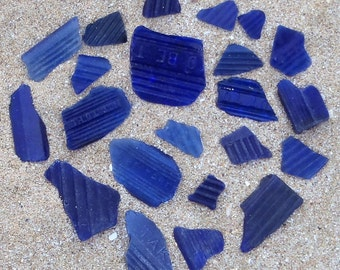 22 fragments of blue seaglass from Victorian poison bottles