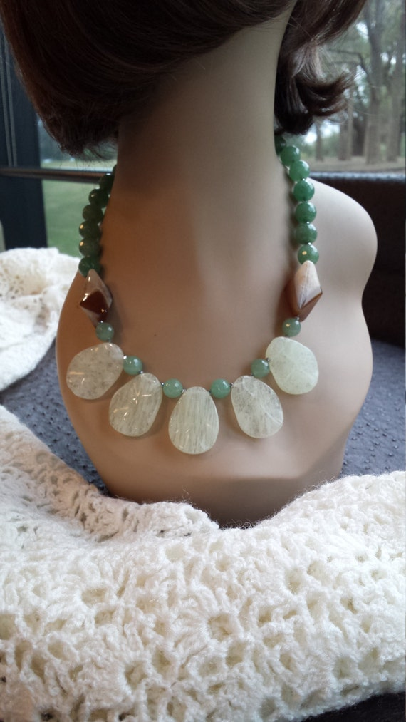 One strand beaded faceted jade, pyramid onyx and opulite teardrops