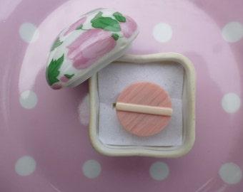 Pink Adjustable ring.