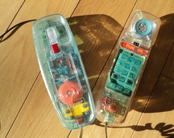 Vintage Touch Tone PHONE WORKS  brand phone with a clear translucent plastic cover which allows you to see in the inside of the phone