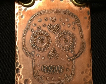 Hand cut, hammered and etched copper sugar skull necklace