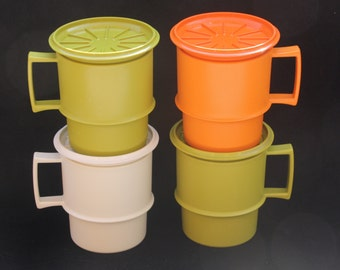 Set of four vintage Lidded and Stackable Tupperware Mugs or Tumblers.
