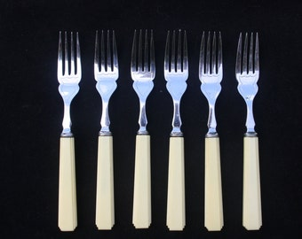 Boxed set of art deco style chrome plate fish knives and forks (two knives not matching) with cream handles