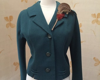 1950s green wool jacket with three quarter sleeves.