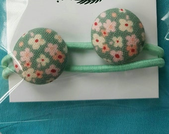 Cute vintage fabric covered button hair elastics.