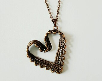 Antique bronze vintage lace heart pendant necklace.