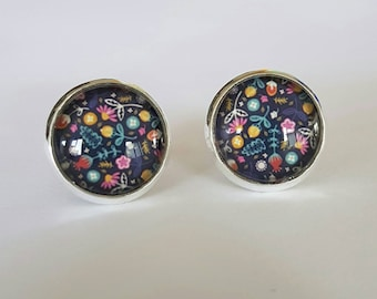 Floral glass cabochon stud earrings.