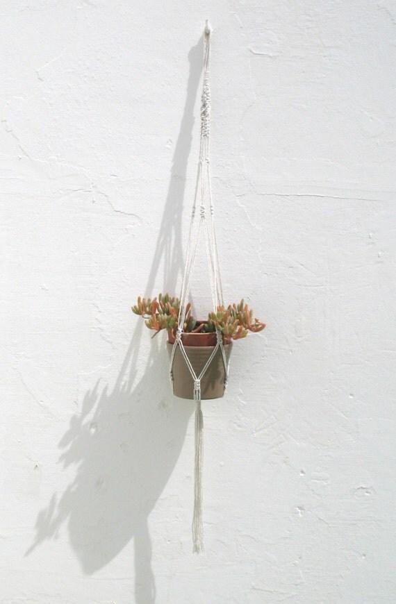 medium hanging macrame plant pot holder in white cotton twine
